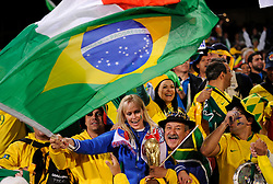 A female Italy fan joins in with the Brazil fans..