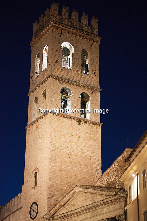 "This is a photograph of the beautiful Municipal Tower from the 14th century in which the ""Bell of Lauds"" was placed in 1926. It is situated on the Piazza Comune in central Assisi."