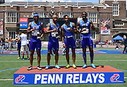 Apr 28, 2018; Philadelphia, PA, USA; Members of the USA Red 4 x 100m relay team pose after winning the USA vs. The World race in 38.39 during the 124th Penn Relays at Franklin Field. From left: Lashon Collins, Tevin Hester, Justin Walker and Justin Gatlin.