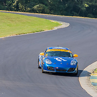 Alton, VA - Aug 26, 2016:  Rebel Rock Racing Borla Urban Grid Porsche Cayman races through the turns at the Oak Tree Grand Prix at Virginia International Raceway in Alton, VA.