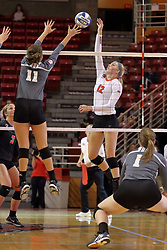 06 November 2015:  Afton Sobasky(11) attempts to thwart an attack by Aly Dawson(12) during an NCAA women's volleyball match between the Bradley Braves and the Illinois State Redbirds at Redbird Arena in Normal IL (Photo by Alan Look)
