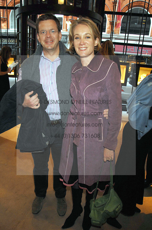 MR JAMES BAKER and his wife TV presenter ANASTASIA COOKE at a party to celebrate the publication of 'Young Stalin' by Simon Sebag-Montefiore at Asprey, New Bond Street, London on 14th May 2007.<br />