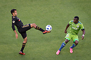 Los Angeles FC defender Steven Beitashour (3) moves the ball against Seattle Sounders defender Nouhou Tolo (5)  during a MLS soccer match in the inaugural game at Banc of California Stadium in Los Angeles, Sunday, April 29, 2018. LAFC defeated the Sounders 1-0. (Eddie Ruvalcaba/mage of Sport)