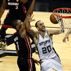 Jun 16, 2013; San Antonio, TX, USA; San Antonio Spurs shooting guard Manu Ginobili (20) drives to the basket against Miami Heat center Chris Bosh (1) during the third quarter of game five in the 2013 NBA Finals at the AT&T Center. Mandatory Credit: Derick E. Hingle-USA TODAY Sports