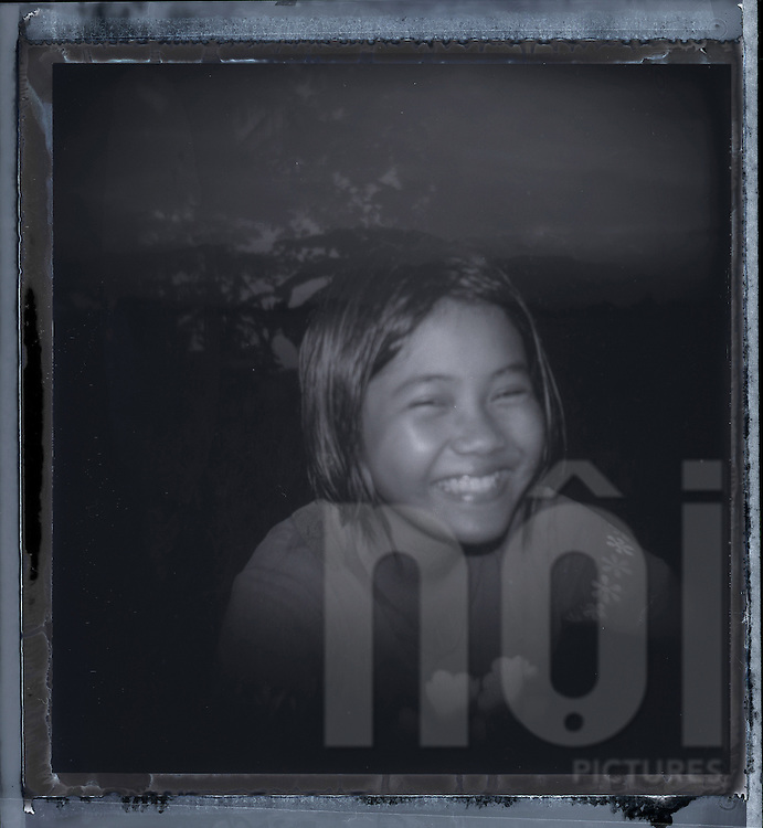 Double exposure portrait of a young Filipino girl smiling at the camera, Palawan island, Philippines, Southeast Asia