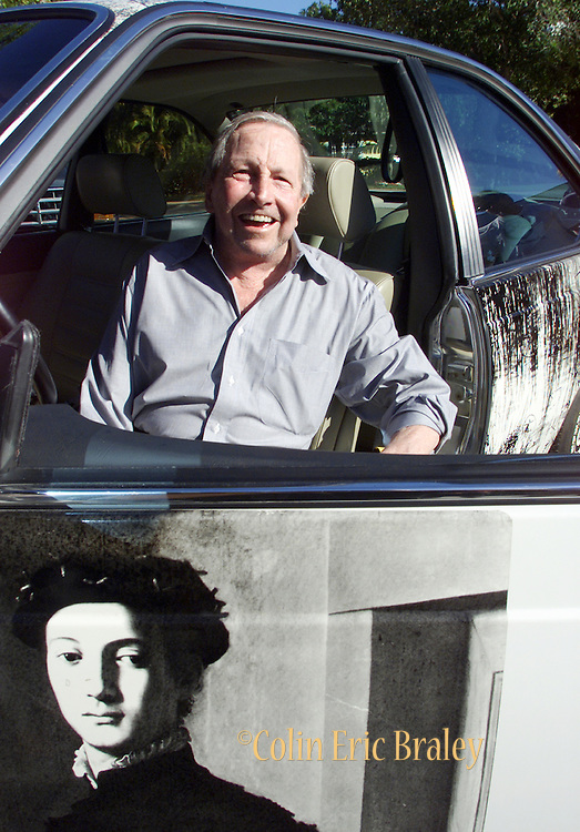 """American pop culture artist Robert Rauschenberg sits in one of his """"Beamer"""" collage cars at an art gallery in Naples, Florida in this July 13, 2002, file photo. The 82-year-old died Monday, May 12, 2008, of heart failure according to Jennifer Joy, his representative at PaceWildenstein gallery in New York. Rauschenberg's incorporation of everyday items, both common place and the odd in his artwork earned him the reputation as a pioneering pop artist, gaining fame in the 1950's. Photo by Colin Braley."""