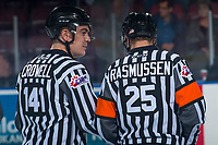 KELOWNA, CANADA - SEPTEMBER 29: Linesman Kevin Crowell and referee Dexter Rasmussen stand on the ice at the Kelowna Rockets against the Everett Silvertips on September 29, 2017 at Prospera Place in Kelowna, British Columbia, Canada.  (Photo by Marissa Baecker/Shoot the Breeze)  *** Local Caption ***