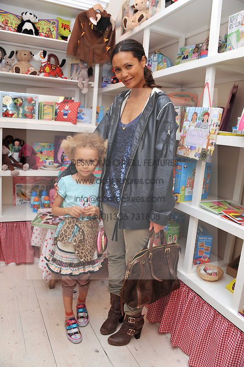 THANDIE NEWTON and her daughter NICO at the opening of the new HoneyJam children's store at 2 Blenheim Crescent, London W11 on 7th July 2011.
