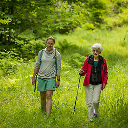 Two women explore the new Bethel Community Forest in Bethel, Maine.