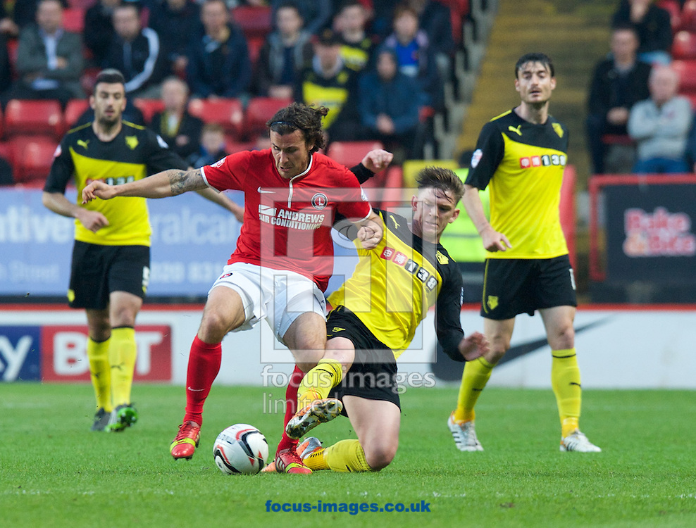 Lawrie Wilson of Charlton Athletic is tackled by Sean Murray of Watford during the Sky Bet Championship match at The Valley, London<br /> Picture by Alan Stanford/Focus Images Ltd +44 7915 056117<br /> 29/04/2014
