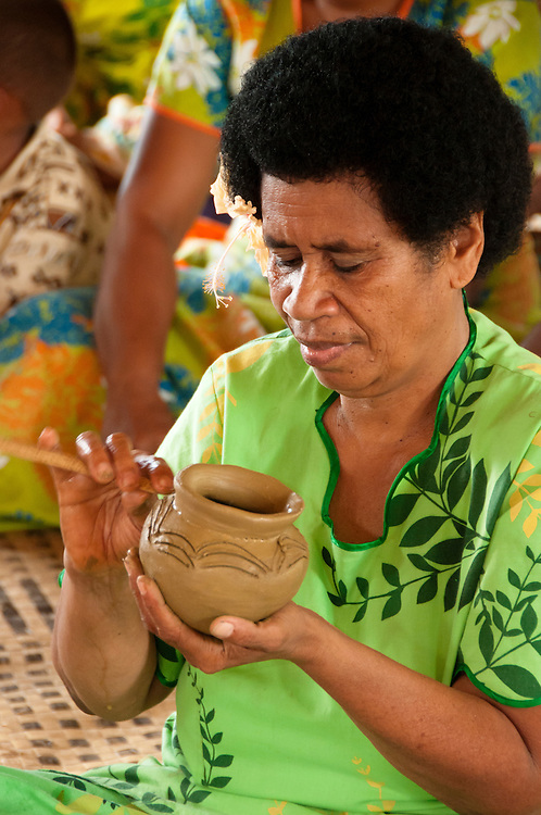 Woman making traditional pottery in Lawai village, Viti Levu Island, Fiji.