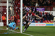 Brentford striker Lasse Vibe scoring the firt goal during the Sky Bet Championship match between Brentford and Milton Keynes Dons at Griffin Park, London, England on 5 December 2015. Photo by Matthew Redman.