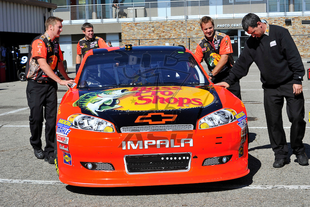 Brooklyn, MI  - Aug 18, 2012: Crew members of the Bass Pro Shop Chevy work not he car before practice for the Pure Michigan 400 at Michigan International Speedway in Brooklyn, MI.