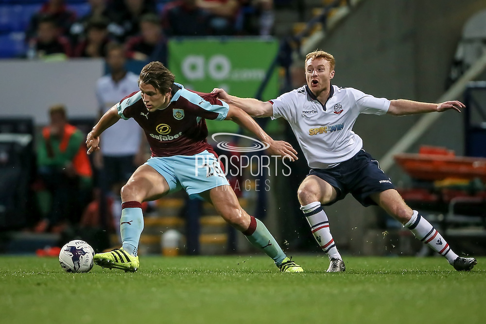 James Tarkowski (Burnley) is pulled back by Chris Taylor (Bolton Wanderers) during the Pre-Season Friendly match between Bolton Wanderers and Burnley at the Macron Stadium, Bolton, England on 26 July 2016. Photo by Mark P Doherty.