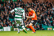 Dundee United Midfielder Scott Fraser has the closest chance at a shot during the Ladbrokes Scottish Premiership match between Celtic and Dundee United at Celtic Park, Glasgow, Scotland on 25 October 2015. Photo by Craig McAllister.