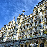 """Régina Palace on Cimiez Hill in Nice, France <br /> The Hôtel Excelsior Régina Palace was built in 1896 on Cimiez Hill in Nice to accommodate Queen Victoria's annual visits to France that were known as her """"French connection.""""  A statue of the United Kingdom's longest reigning monarch is in the gardens nearby.  This elegant building that reflects the prosperity of the Belle Époque period is now for residential use."""
