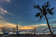 Fishing boats with outriggers at sunset, Bali, Indonesia