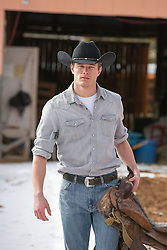 hot cowboy on a rustic ranch