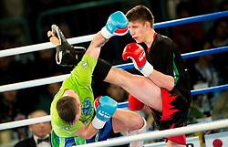 Grega Rudolf of Slovenia (Blue) vs David Elszzaszer of Hungary (Red) in Kickboxing Kick Light during First Class Boxing event, on April 11, 2015 in Arena Tabor, Maribor, Slovenia. Photo by Vid Ponikvar / Sportida