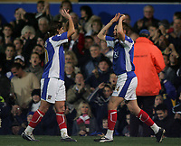 Photo: Lee Earle.<br /> Portsmouth v Aston Villa. The Barclays Premiership. 02/12/2006. Portsmouth's Pedro Mendes (L) congratulates Matthew Taylor after he scored their second from the penalty spot.