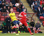Oxford forward Ryan Taylor and Leyton Orient defender Mathieu Baudry compete for a high ball during the Sky Bet League 2 match between Leyton Orient and Oxford United at the Matchroom Stadium, London, England on 17 October 2015. Photo by Bennett Dean.