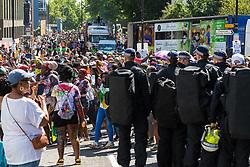 London, August 27 2017. Police watch the crowds on Ladbroke Grove as Family Day of the Notting Hill Carnival gets underway. The Notting Hill Carnival is Europe's biggest street party held over two days of the bank holiday weekend, attracting over a million people. © Paul Davey.