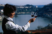 January 1998, Porto, Portugal --- Women Holding Varieties of Port-Wine --- Image by © Owen Franken/CORBIS