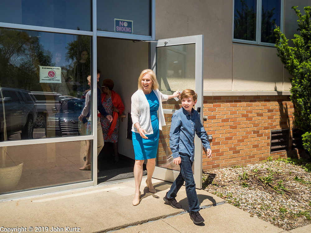 26 MAY 2019 - WATERLOO, IOWA: US Senator KIRSTEN GILLIBRAND (D-NY) and son, HENRY GILLIBRAND, 11, walk out of Mt. Carmel Missionary Baptist Church in Waterloo Sunday. Sen. Gillibrand is on her 5th trip to Iowa this week to support her candidacy to be the Democratic nominee for the US Presidency. Iowa traditionally hosts the the first selection event of the presidential election cycle. The Iowa Caucuses will be on Feb. 3, 2020. Mt. Carmel Missionary Baptist Church was established in 1921 and is the third oldest African-American church in Waterloo. Waterloo has the largest African-American community in Iowa.             PHOTO BY JACK KURTZ