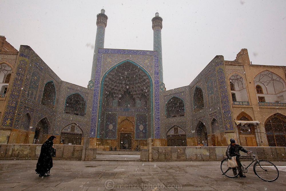 Snowfalling over the magnificently tiled Masjed-e Imam (Royal Mosque)  (Also referred to as Emam Square). Built by the Safavid ruler, Shah Abbas 1, as part of the renovation of the central square of Isfahan. The architect was Ostad Abu'l-Qasim.  (Imam Square is also called Naghsh-i Jahan Square).