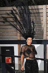 Lady GaGa wearing a feathered headpiece, sheer top and black trousers leaving the ITV studios in London, after appearing on The Graham Norton Show. UK. 29/10/2013<br />
