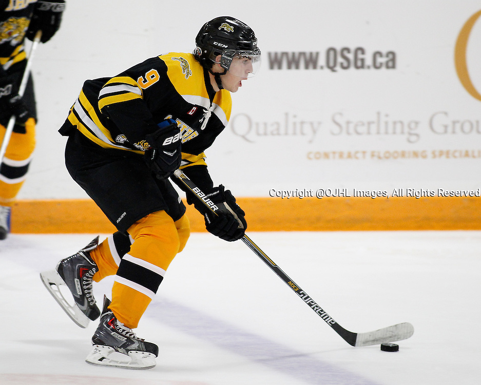 AURORA, ON - Sep 18, 2015 : Ontario Junior Hockey League game action between St. Michael's and Aurora,  Daniel Mantenuto #9 skates with the puck during the first period.<br /> (Photo by Brian Watts / OJHL Images)