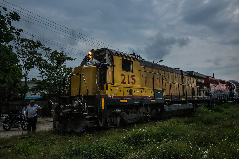 """TENOSIQUE, MEXICO - MAY 29, 2014: The train called, """"The Beast"""" goes from southern Mexico to just south of the Texas border.  Migrants have ridden on top of its train cars for years during their journey north.  In recent months, authorities have noted a boom in child migrants arriving in the United States. PHOTO: Meridith Kohut for The New York Times"""