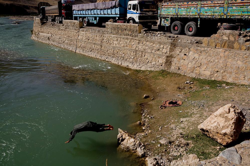 Truck driver bathes along Salang Pass near Jabul Saraj.