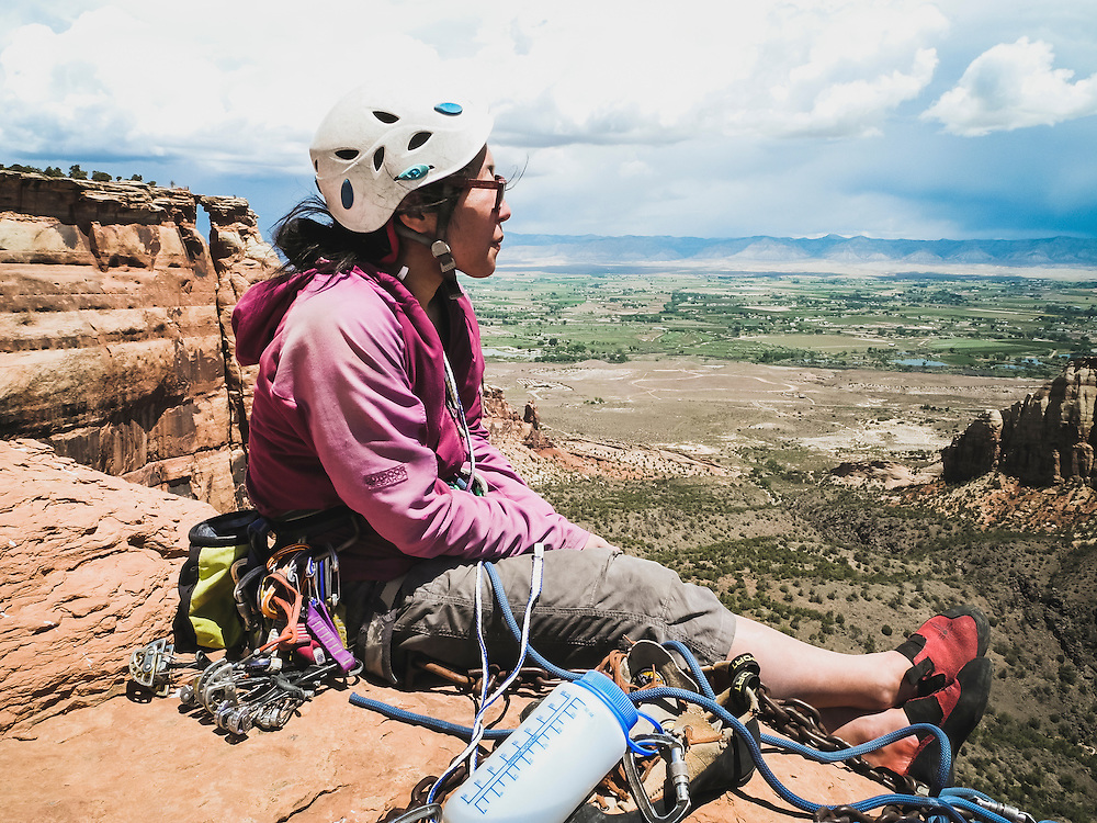 Shiho Kobayashi enjoys the view from the summit of Sentinel Spire, Colorado National Monument.