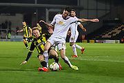 Burton Albion forward Mark Duffy wins the ball in a hard challenge with Crewe Alexandra forward Callum Saunders during the Sky Bet League 1 match between Burton Albion and Crewe Alexandra at the Pirelli Stadium, Burton upon Trent, England on 20 October 2015. Photo by Aaron Lupton.