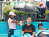 Tennis - 2019 Queen's Club Fever-Tree Championships - Day One, Monday<br /> <br /> Men's Singles, First Round: Cameron Norrie (GBR) Vs. Kevin Anderson (RSA)  <br /> <br /> Cameron Norrie (GBR) takes refuge under the shade from the heat of Centre Court.<br />  <br /> COLORSPORT/DANIEL BEARHAM