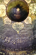 Detail of a bronze gong in Mahamuni pagoda, Mandalay, Burma (Myanmar).