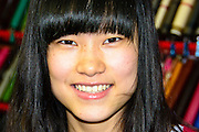 Portrait of a young smiling Chinese woman