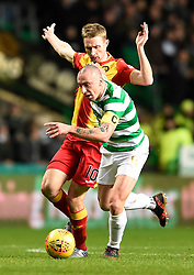 Partick's Chris Erskine and Celtic's Scott Brown during the Scottish Premiership match at Celtic Park, Glasgow. PRESS ASSOCIATION Photo. Picture date: Wednesday December 20, 2017. See PA story SOCCER Celtic. Photo credit should read: Ian Rutherford/PA Wire. RESTRICTIONS: EDITORIAL USE ONLY