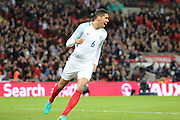England defender, Chris Smalling (06) celebrating scoring  opening goal during the Friendly International match between England and Portugal at Wembley Stadium, London, England on 2 June 2016. Photo by Matthew Redman.