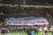 Both teams come out with the never die in memory of munich flag in the crowd during the Barclays Premier League match between Manchester United and Stoke City at Old Trafford, Manchester, England on 2 February 2016. Photo by Phil Duncan.