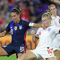 United States forward Carli Lloyd (10) and England defender Leah Williamson (14) fight for the ball is during the first match of the 2020 She Believes Cup soccer tournament at Exploria Stadium on 5 March 2020 in Orlando, Florida USA.