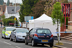 © Licensed to London News Pictures.  20/05/2013. LUTON, UK. General view of the scene of a shooting, the 10th this year, in Luton. The incident occurred at 8am this morning (20/5) after a collision between two cars. As the victim got out of the car to remonstrate he was shot in the leg and is in a serious condition in hospital. Armed officers are routinely patrolling nearby Marsh Farm following a spate of shootings there. Photo credit: Cliff Hide/LNP