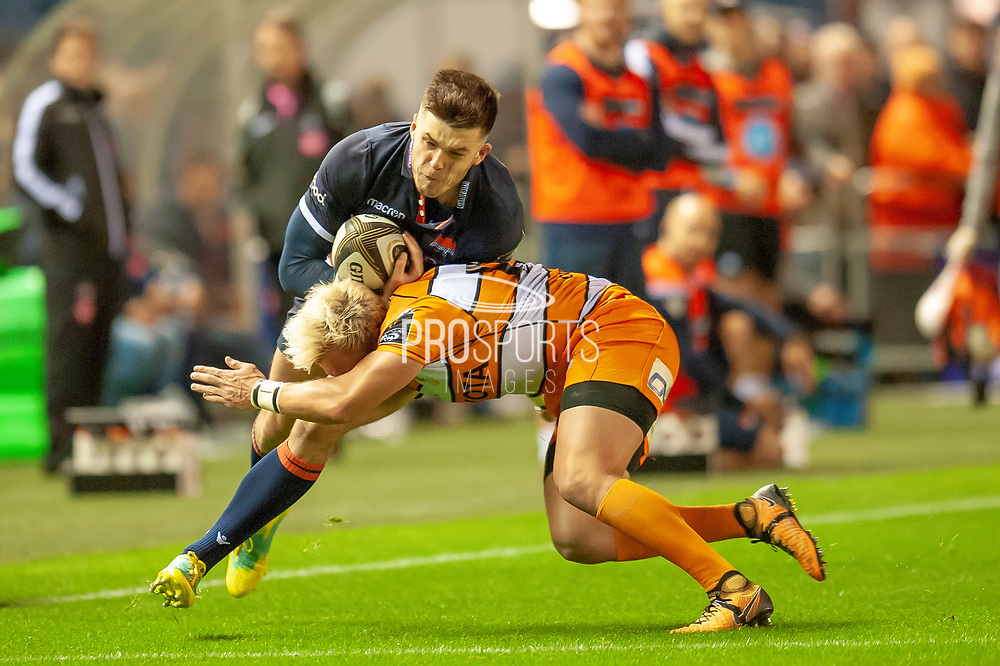 Blair Kinghorn (#15) of Edinburgh Rugby is tackled by Tian Schoeman (#10) of Toyota Cheetahs during the Guinness Pro 14 2018_19 match between Edinburgh Rugby and Toyota Cheetahs at BT Murrayfield Stadium, Edinburgh, Scotland on 5 October 2018.