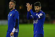 Ryan Flynn and Carl Winchester of Oldham Athletic applaud the fans at the end of the EFL Sky Bet League 1 match between Oldham Athletic and Scunthorpe United at Boundary Park, Oldham, England on 18 October 2016. Photo by Simon Brady.