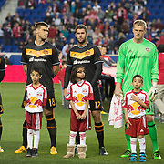 Mar 19, 2016; Harrison, NJ, USA; Houston Dynamo players stand with fans during the national anthem at Red Bull Arena. Red Bulls defeat the Dynamo 4-3. Mandatory Credit: William Hauser-USA TODAY Sports