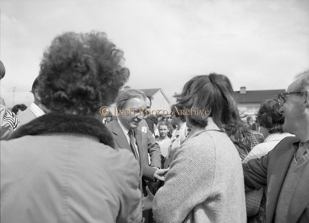 Taoiseach's Election Campaign.      (N77)..1981..23.05.1981..05.23.1981..23rd May 1981..On the 21st May the Taoiseach, Mr Charles Haughey, dissolved the Dáil and called a general election. Charles Haughey, Garret Fitzgerald and Frank Cluskey were leading their respective parties into a general election for the first time as they had only taken party leadership during the last Dáil..Fianna Fáil had hoped to call the election earlier, but the Stardust Tragedy caused the decision to be deferred...Charles Haughey is pictured meeting and greeting supporters on the campaign trail.