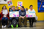 The McTaggarts, from right, Kim, Glenn and Cameron, hold their welcome signs up as students from Ono Cho, Japan arrive at Revelstoke Secondary School on Feb. 1, 2018 for their annual exchange.