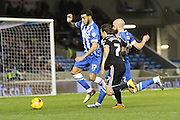 Brighton central defender, Connor Goldson (17) clears the challenge from Brentford midfielder Sam Saunders during the Sky Bet Championship match between Brighton and Hove Albion and Brentford at the American Express Community Stadium, Brighton and Hove, England on 5 February 2016. Photo by Geoff Penn.