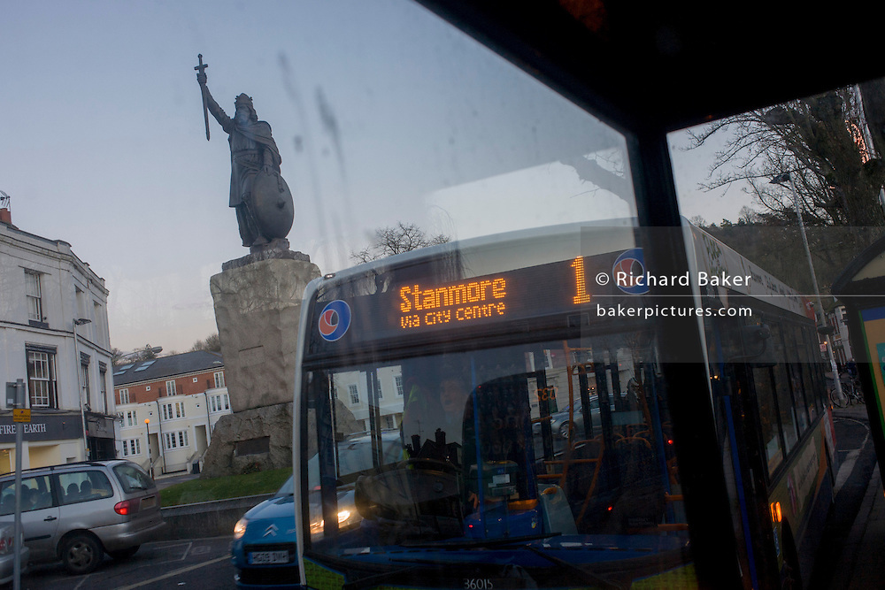 "Towering over a Stagecoach bus service is the statue (by sculptor Hamo Thornycroft) of Saxon King Alfred that overlooks a modern Winchester, Hampshire, England. Alfred the Great (849 - 899) was King of Wessex from 871 to 899. Alfred successfully defended his kingdom against the Viking attempt at conquest, and by his death had become the dominant ruler in England. He is the only English monarch to be accorded the epithet ""the Great"". The Thornycroft statue was unveiled during the millenary celebrations of Alfred's death."